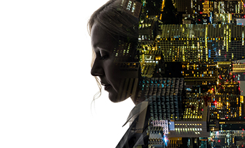 A lady with a circuit board behind her head and body