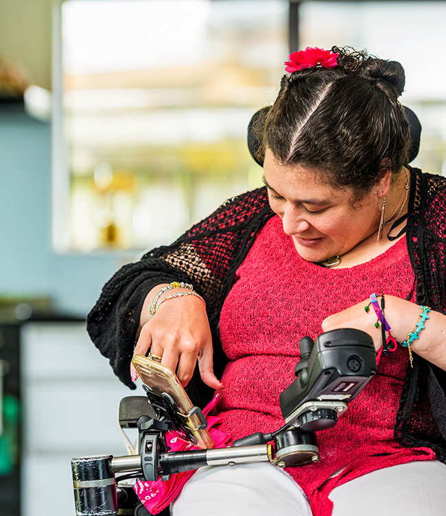 Woman with disability using smartphone